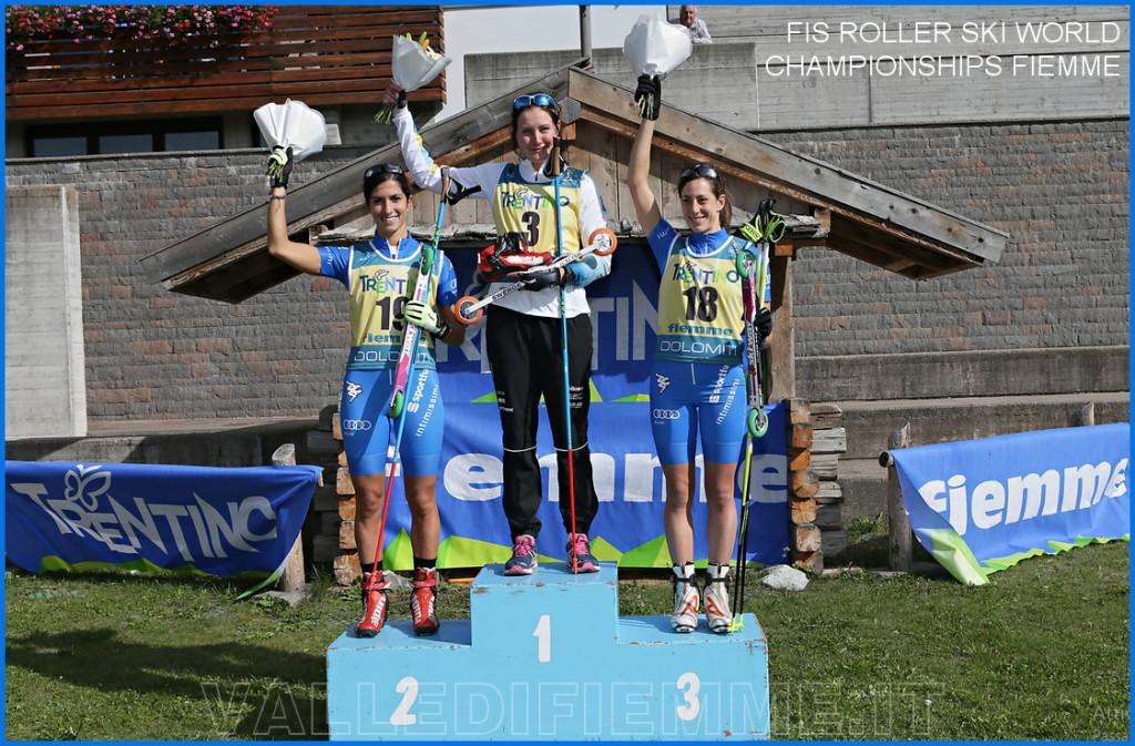 mondiali skiroll fiemme 2015 bellamonte podio femminile 1024x673 Chiusura Mondiali Skiroll Fiemme 2015 con tripletta russa   Video
